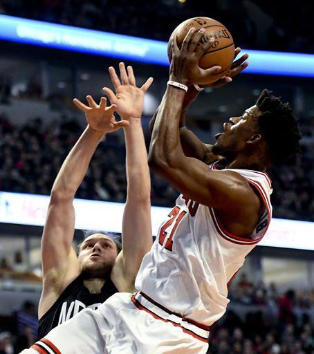 e66f6ecae9f Chicago Bulls forward Jimmy Butler (21) shoots against Brooklyn Nets guard  Bojan Bogdanovic