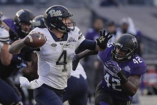Pittsburgh quarterback Nathan Peterman (4) throws under pressure from Northwestern linebacker Joseph Jones (42) during the first quarter of the Pinstripe Bowl NCAA college football game, Wednesday, Dec. 28, 2016, in New York.