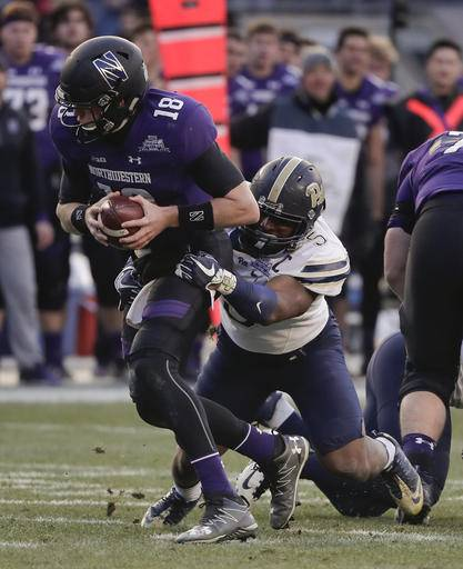 Northwestern quarterback Clayton Thorson (18) is sacked by Pittsburgh defensive lineman Ejuan Price (5) during the second quarter of the Pinstripe Bowl NCAA college football game, Wednesday, Dec. 28, 2016, in New York.