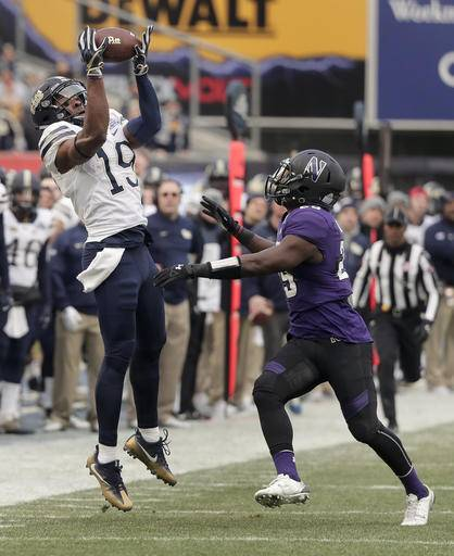 Pittsburgh wide receiver Dontez Ford (19) makes a catch against Northwestern defensive back Trae Williams (29) during the first quarter of the Pinstripe Bowl NCAA college football game, Wednesday, Dec. 28, 2016, in New York.