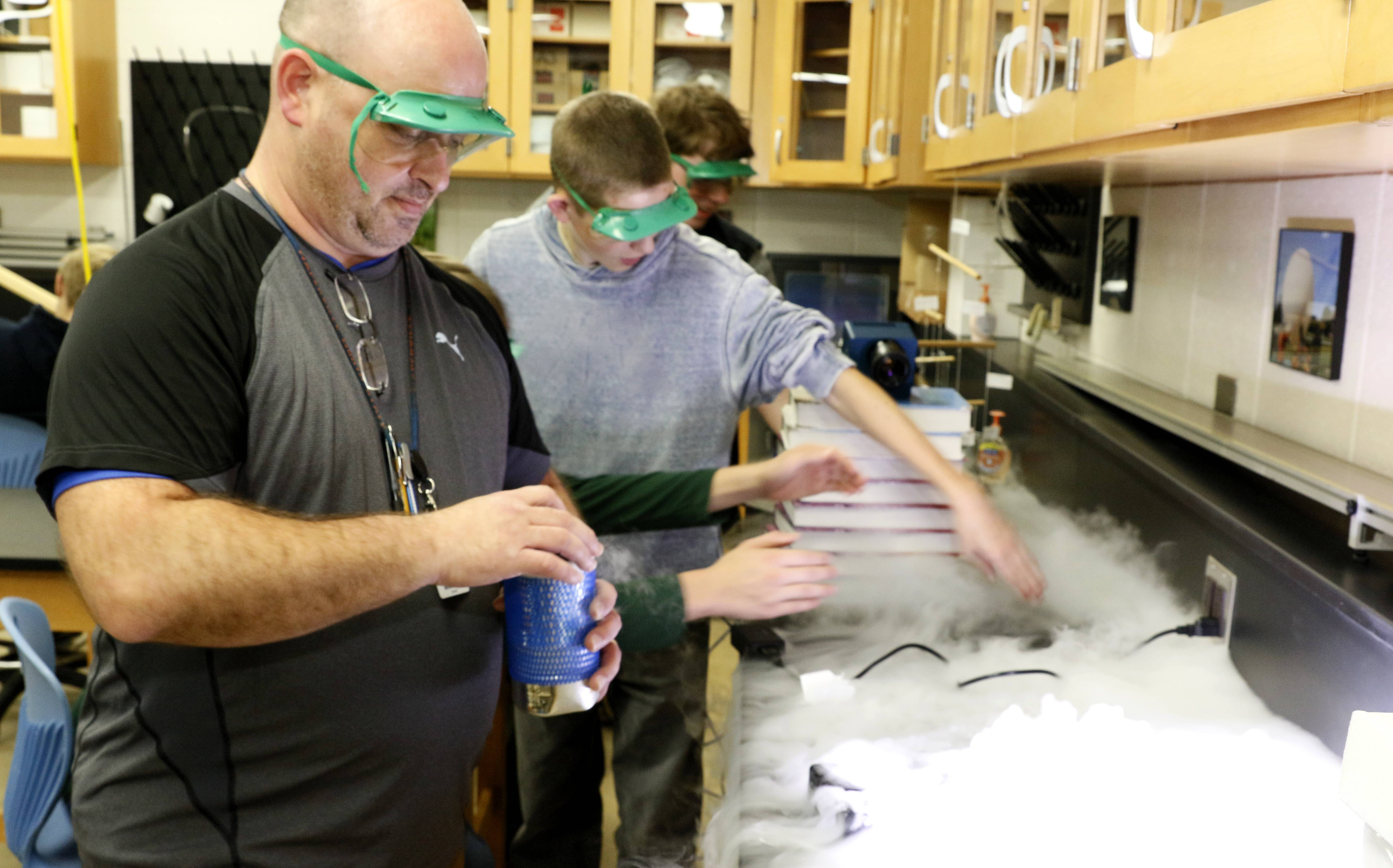 The highest among unit districts: Naperville North High School science teacher Mark Rowzee and his students work on a project involving mixing hot water with liquid nitrogen. Naperville District 203 offers top teacher pay among unit districts with an average salary of $78,253.