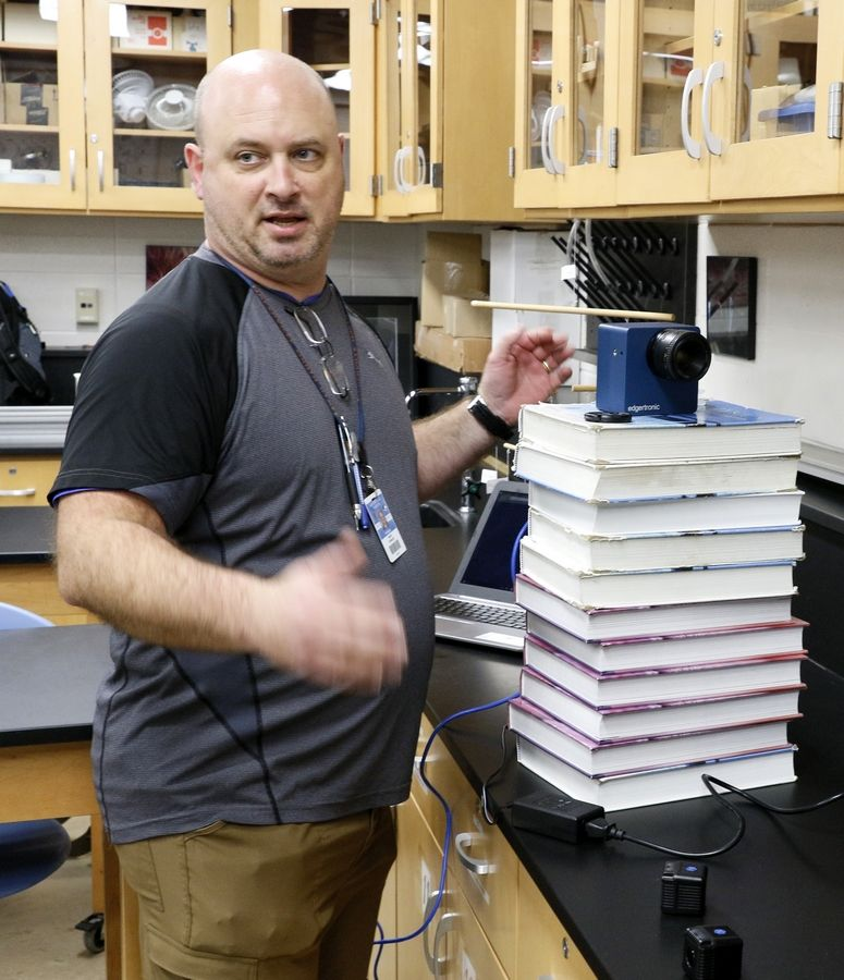 Naperville North High School science teacher Mark Rowzee sets up a high speed camera to record in super slow motion.