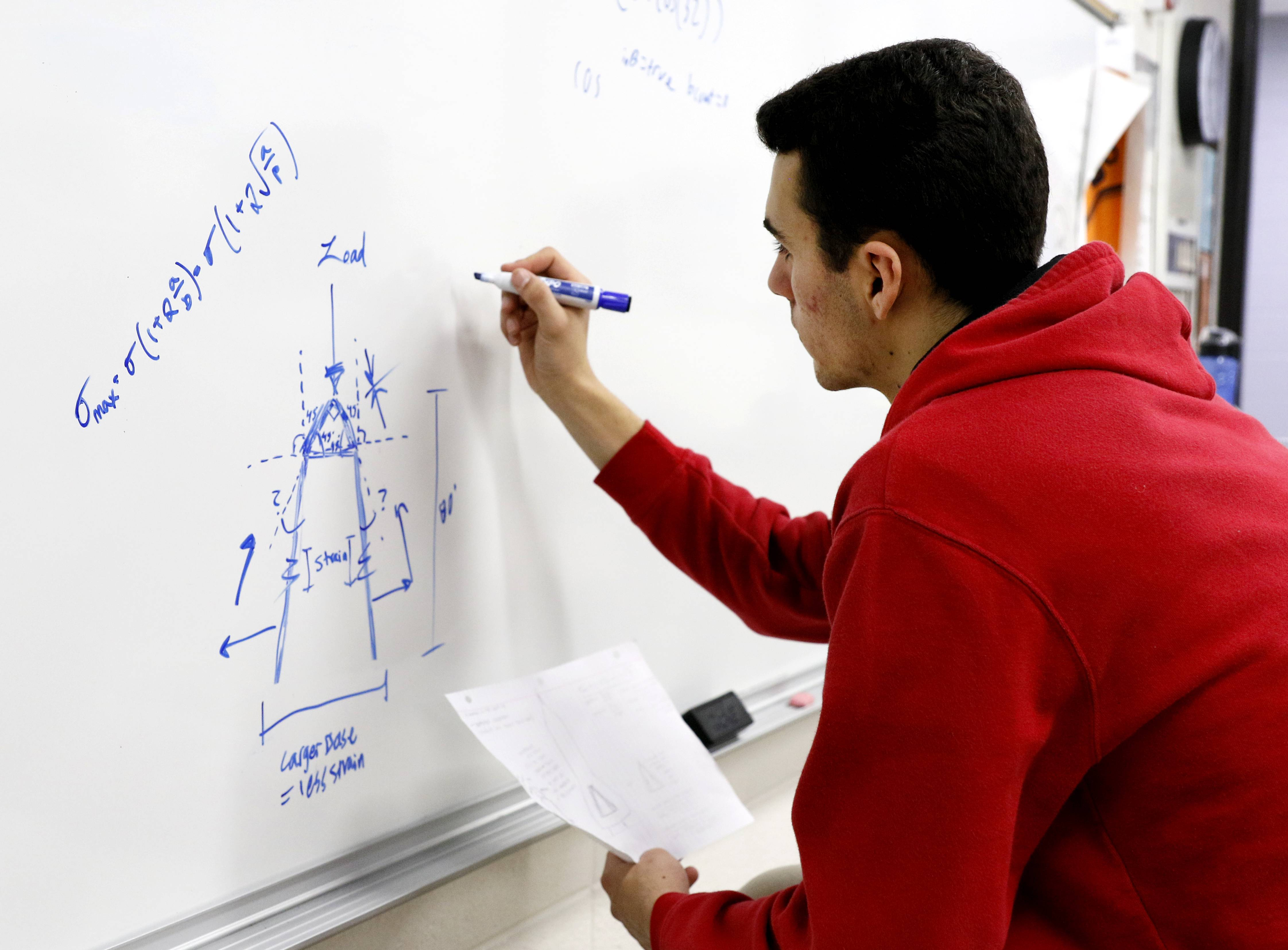 Nick Beck works on a building design Naperville North High School science teacher Mark Rowzee's class.