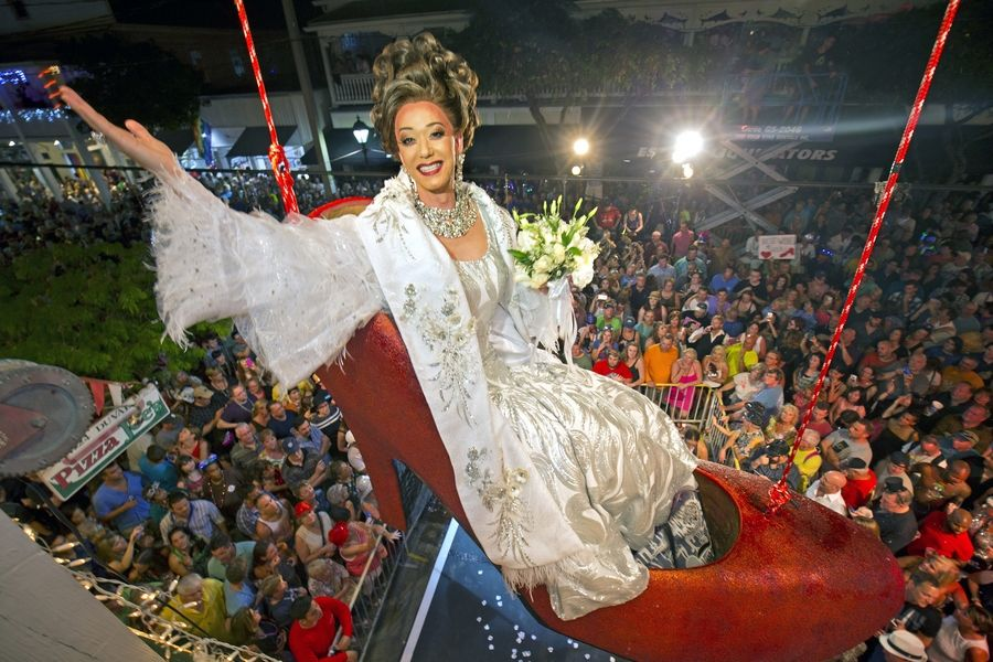 Female impersonator Gary Marion, known as Sushi, hangs in a giant replica of a woman's high heel shoe in Key West, Fla., last year. The Big Red Shoe Drop is one of several of the subtropical island city's takeoffs on New York City's Times Square ball drop.