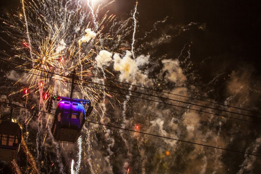A brightly lit gondola drops at Heavenly Mountain Resort in South Lake Tahoe, Nev. It's one of a number of ceremonies in which various objects are dropped around the country to welcome in the new year.