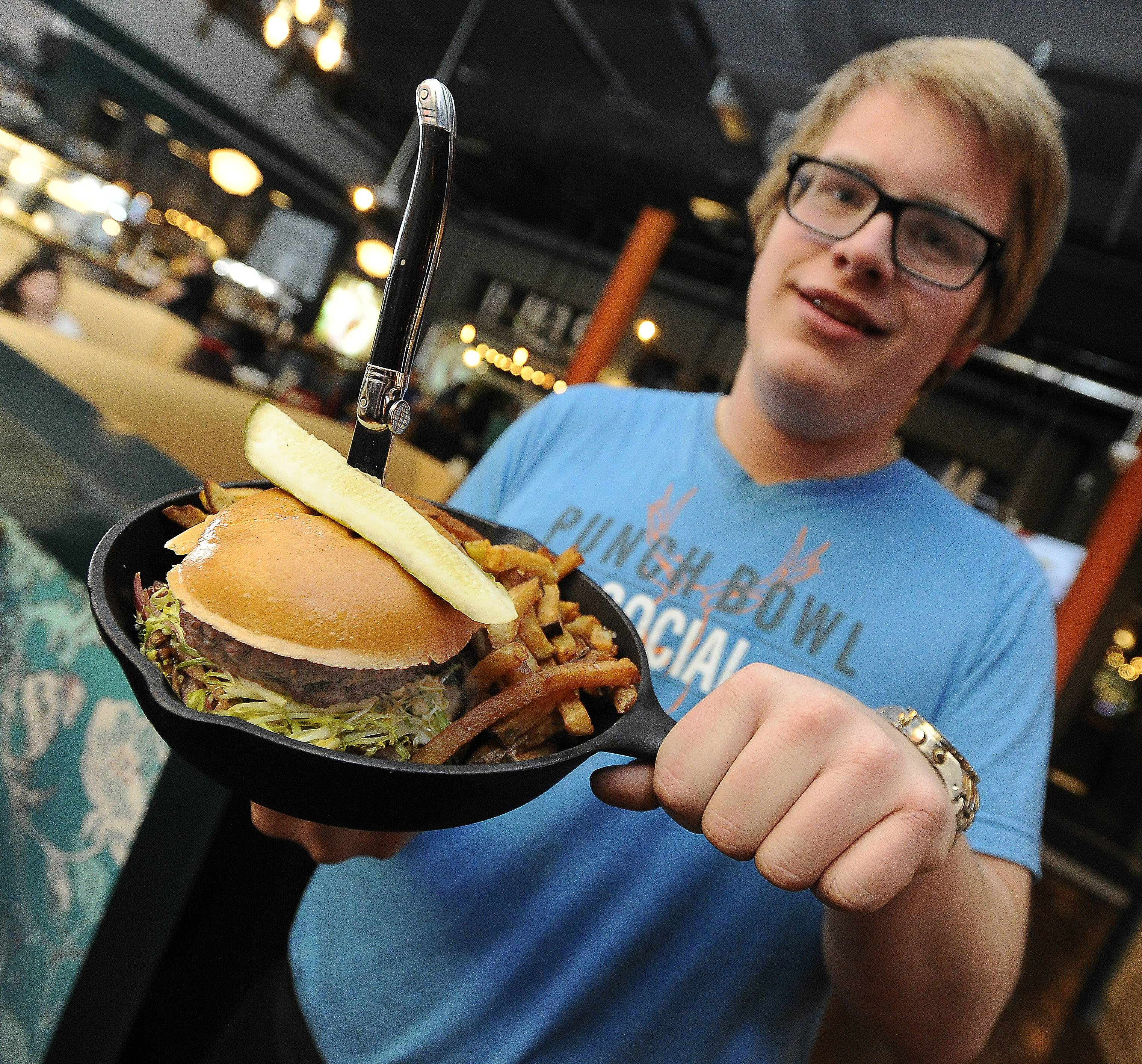 Punch Bowl Social's Mitch Korf serves up a juicy burger.