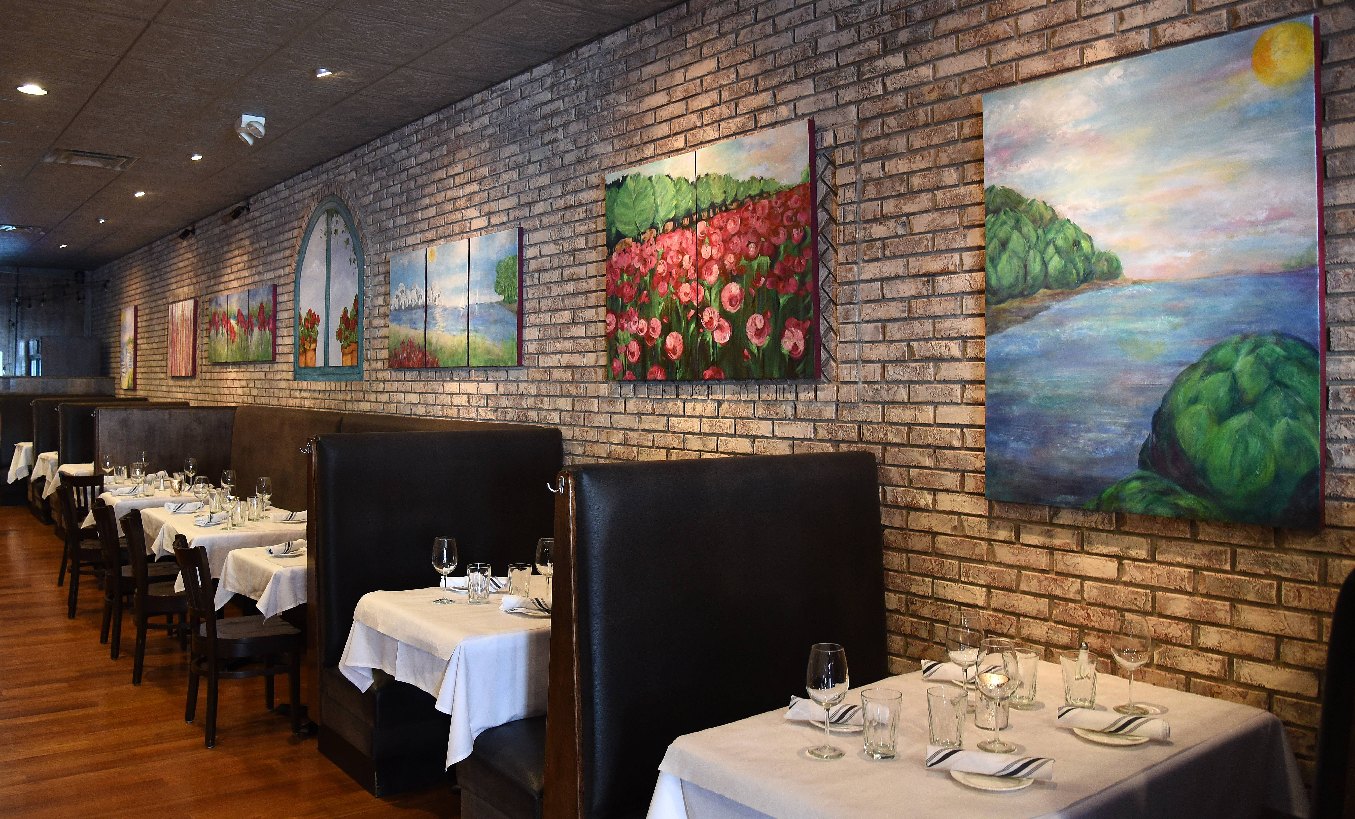 Artwork on the brick walls adds an air of sophistication to the dining room at Retro Bistro in Crystal Lake.