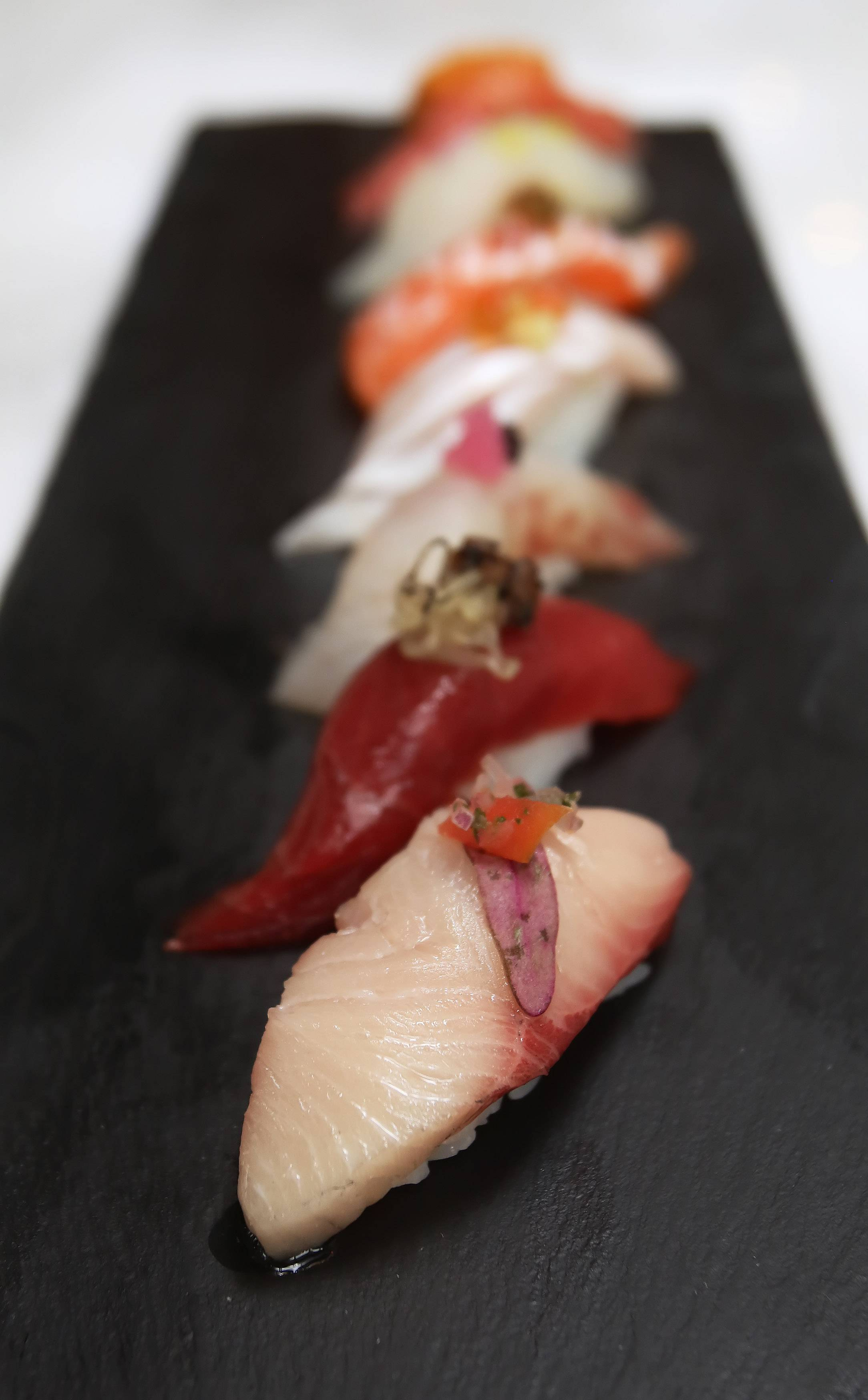 The chef's signature nigiri includes six artfully crafted pieces at Blufish Sushi in Vernon Hills.