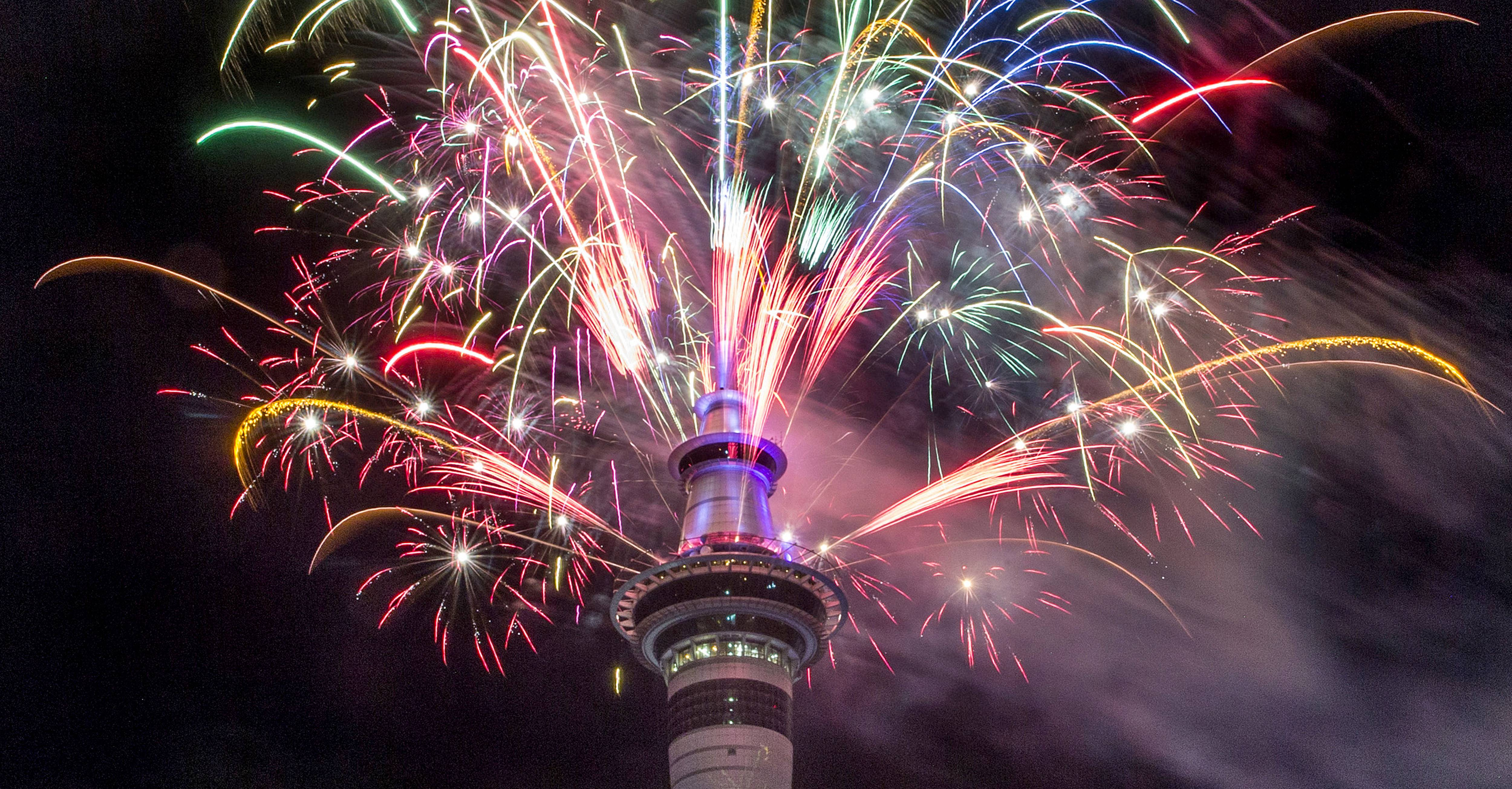 Fireworks explode from Auckland's Sky Tower as the new year is welcomed to New Zealand, Jan 1, 2017.