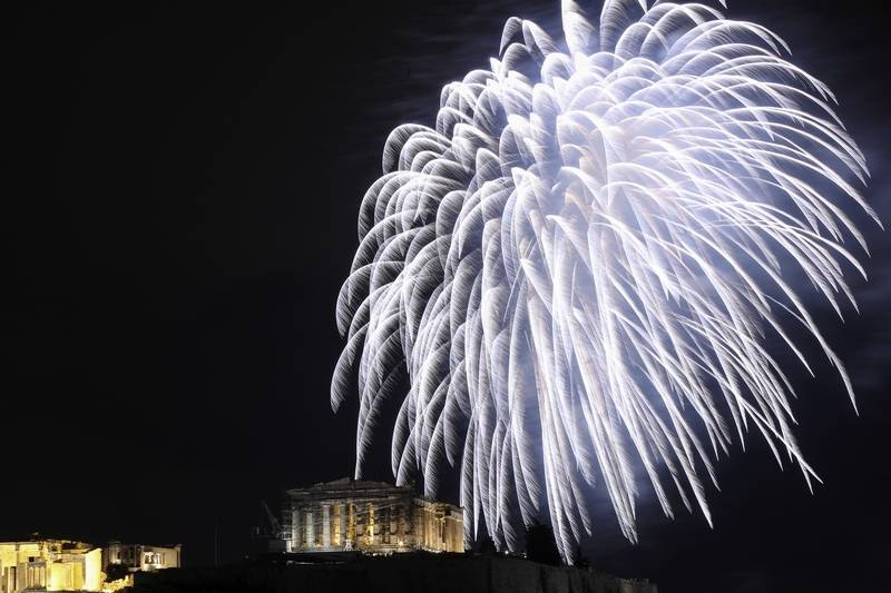 Fireworks explode over the temple of the Parthenon at the Acropolis hill during the New Year celebrations in Athens, Sunday.