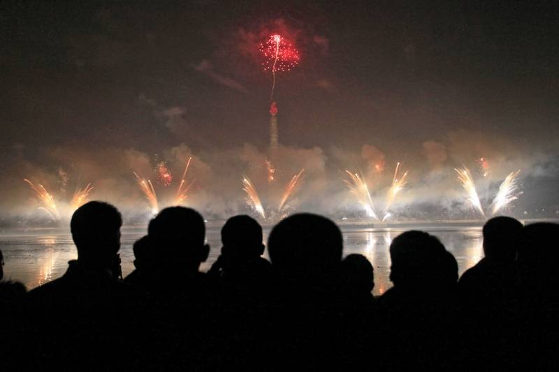 North Koreans gather to watch a New Year's fireworks display at the Kim Il Sung Square in Pyongyang, North Korea, on Sunday.
