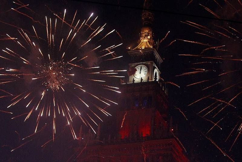 Spectators watch fireworks in front of the Palace Kultury during the New Year celebrations in Warsaw, Poland, Sunday, Jan. 1, 2017. Thousands of Warsaw residents took to the streets in the capital to usher in the New Year.