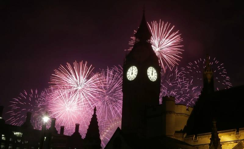 Fireworks explode over Elizabeth Tower housing the Big Ben clock to celebrate the New Year in London, Sunday, Jan. 1, 2017.