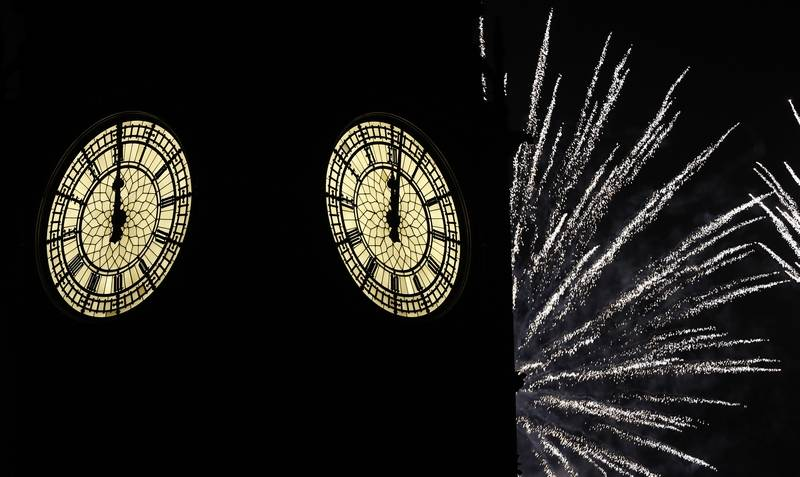 Fireworks explode over Elizabeth Tower housing the Big Ben clock to celebrate the New Year in London, Sunday, Jan. 1, 2016.