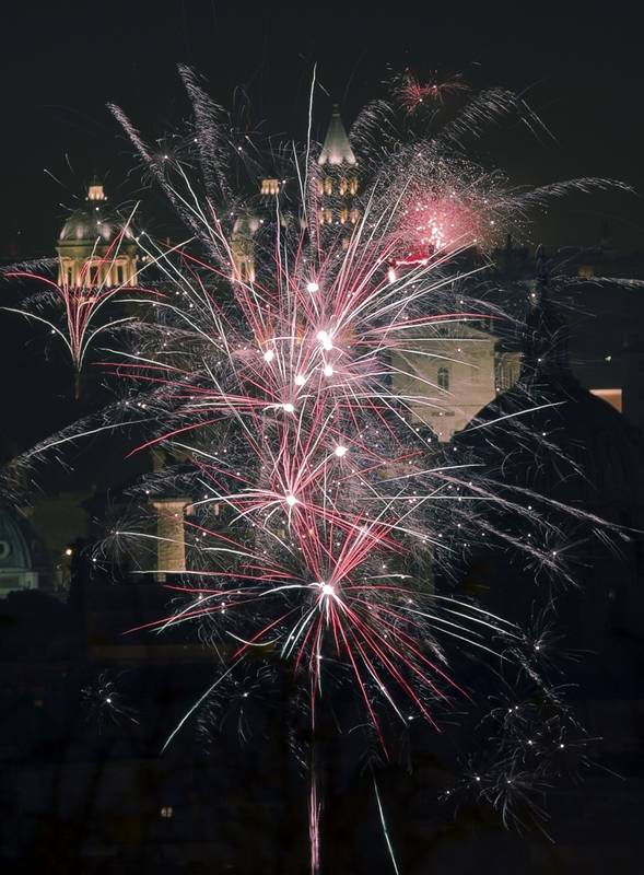 Fireworks explode in the sky over Rome as people celebrated the new year Sunday, Jan. 1, 2017.