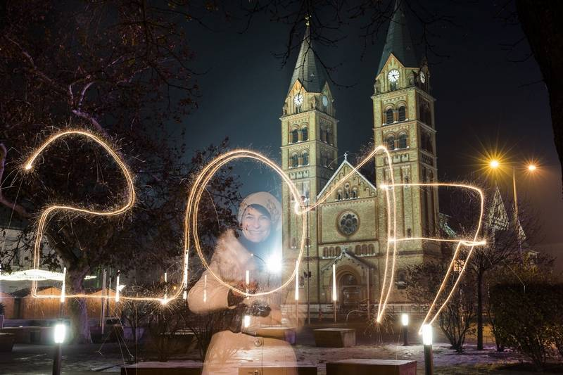 A young woman writes '2017' using a sparkler during the New Year's Eve celebrations in Nyiregyhaza, about 152 miles east of Budapest, Hungary, Saturday, Dec. 31, 2016.