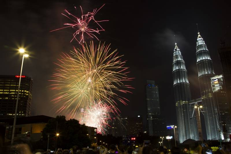 Fireworks explode in front of Malaysia's landmark building, Petronas Twin Towers, during the New Year's Eve celebration in Kuala Lumpur, Malaysia, early Sunday, Jan. 1, 2017.
