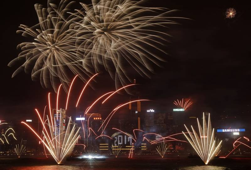 Fireworks explode over Victoria Harbour to celebrate the New Year's Eve in Hong Kong, early Sunday, Jan. 1, 2017.