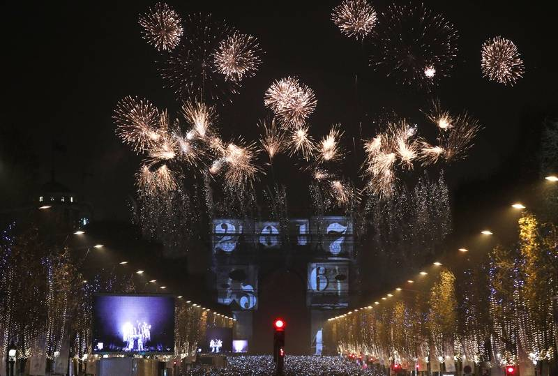 The 2017 appears during a firework over the Arc de Triomphe as part of the New Year celebrations on the Champs Elysees in Paris, France, Sunday, Jan.1, 2017.
