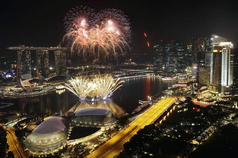 Fireworks explode above Singapore's financial district at the stroke of midnight to mark the New Year's celebrations on Sunday, in Singapore.