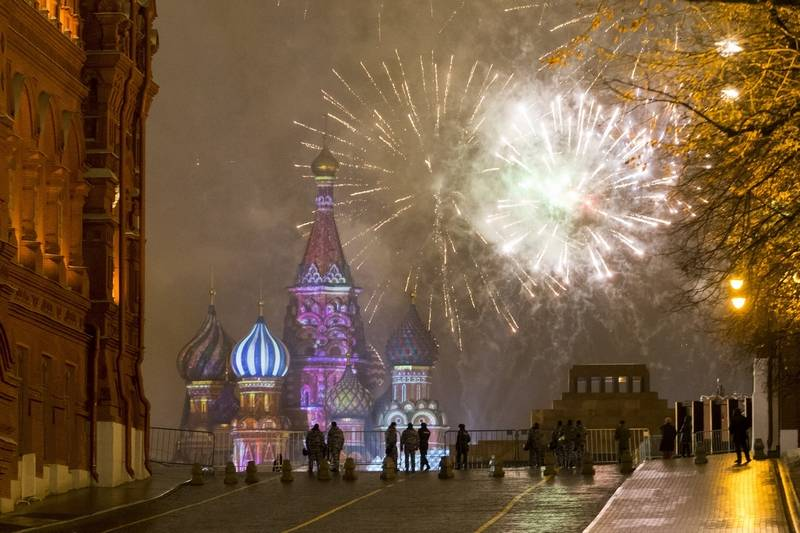 Fireworks explode over the Kremlin in Red Square which was blocked by police during New Year celebrations in Moscow, Russia, Sunday. New Year's Eve is Russia's major gift-giving holiday, and big Russian cities were awash in festive lights and decorations.