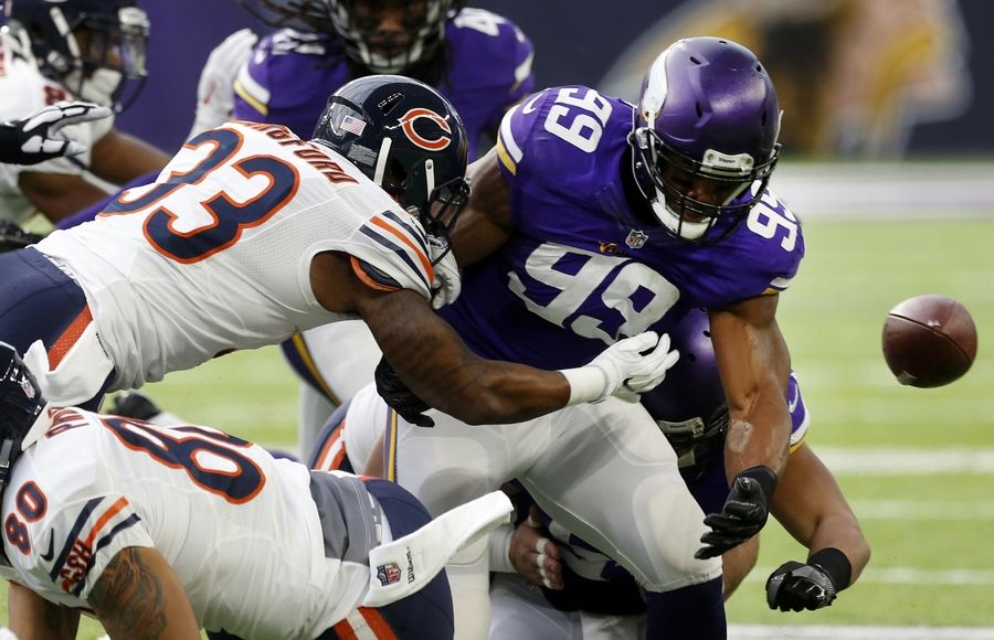 Minnesota Vikings defensive end Danielle Hunter (99) looks to recover a fumble by Chicago Bears running back Jeremy Langford (33) during the first half of an NFL football game Sunday, Jan. 1, 2017, in Minneapolis. The Vikings recovered the ball.