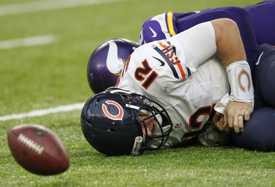 Chicago Bears quarterback Matt Barkley (12) fumbles the ball as he is sacked by Minnesota Vikings defensive tackle Linval Joseph, rear, during the second half of an NFL football game Sunday, Jan. 1, 2017, in Minneapolis.