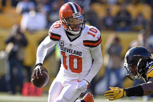 ab24a1efa41 Cleveland Browns quarterback Robert Griffin III (10) rolls out under  pressure by Pittsburgh Steelers L.T. Walton 96 ...