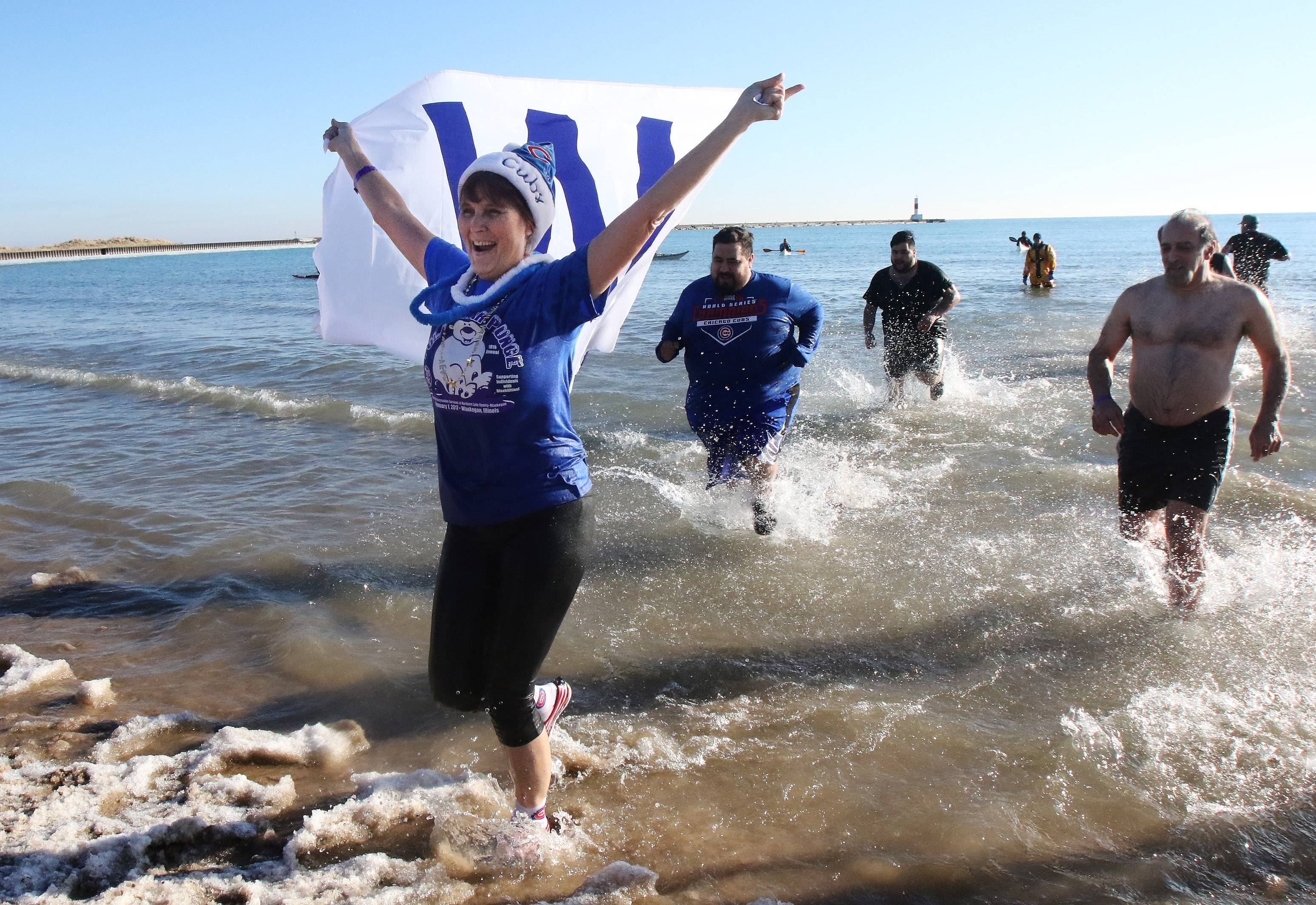 Cubs fan Diane Cullen of Grayslake comes out of the lake after participating in the 18th Annual Polar Bear Plunge on New Year's Day at the Waukegan Municipal Beach. The event was sponsored by the City of Waukegan and the Waukegan Park District to support the Special Recreation Services of Northern Lake County.