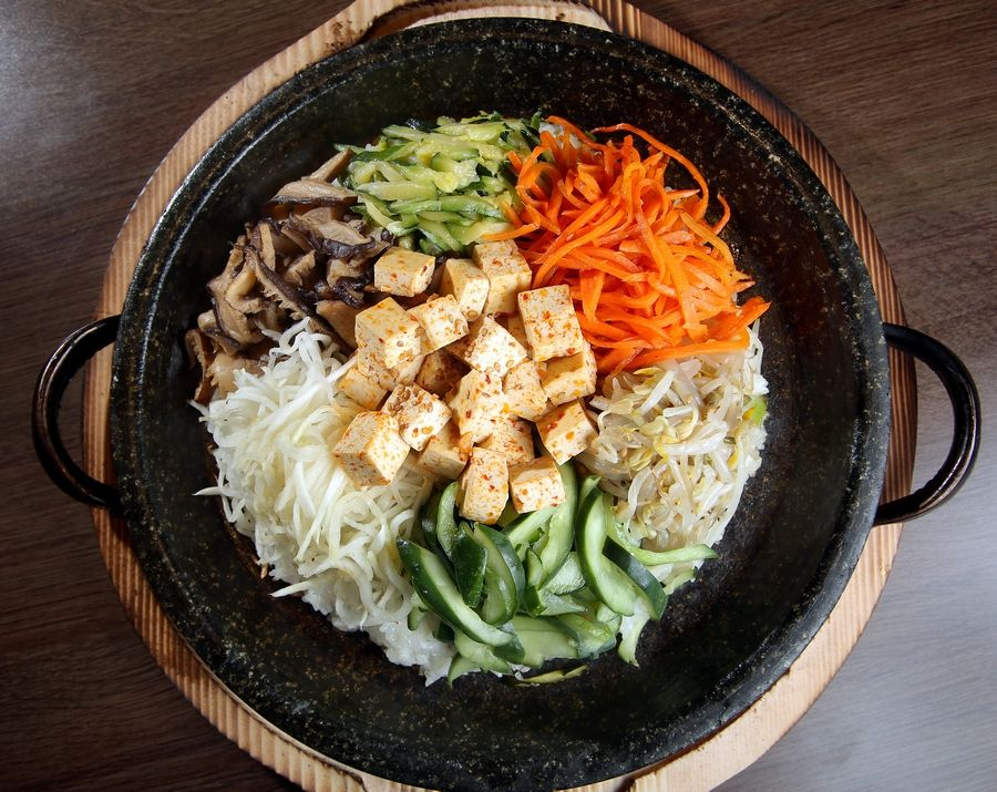 Tofu bibimbap -- steamed rice topped with sauteed vegetables on a hot stone plate -- is a popular dish at So Gong Dong.