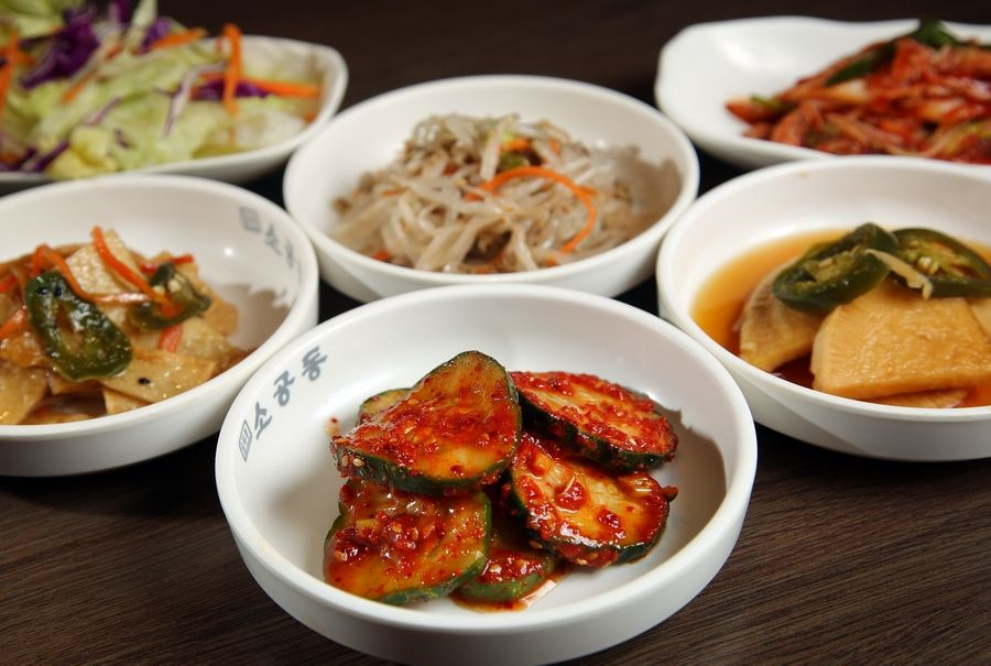 Traditional Korean side dishes like zucchini, kimchi, fish cake, sprouts and a warm soup with noodles will sate hungry appetites at Schaumburg's So Gong Dong.