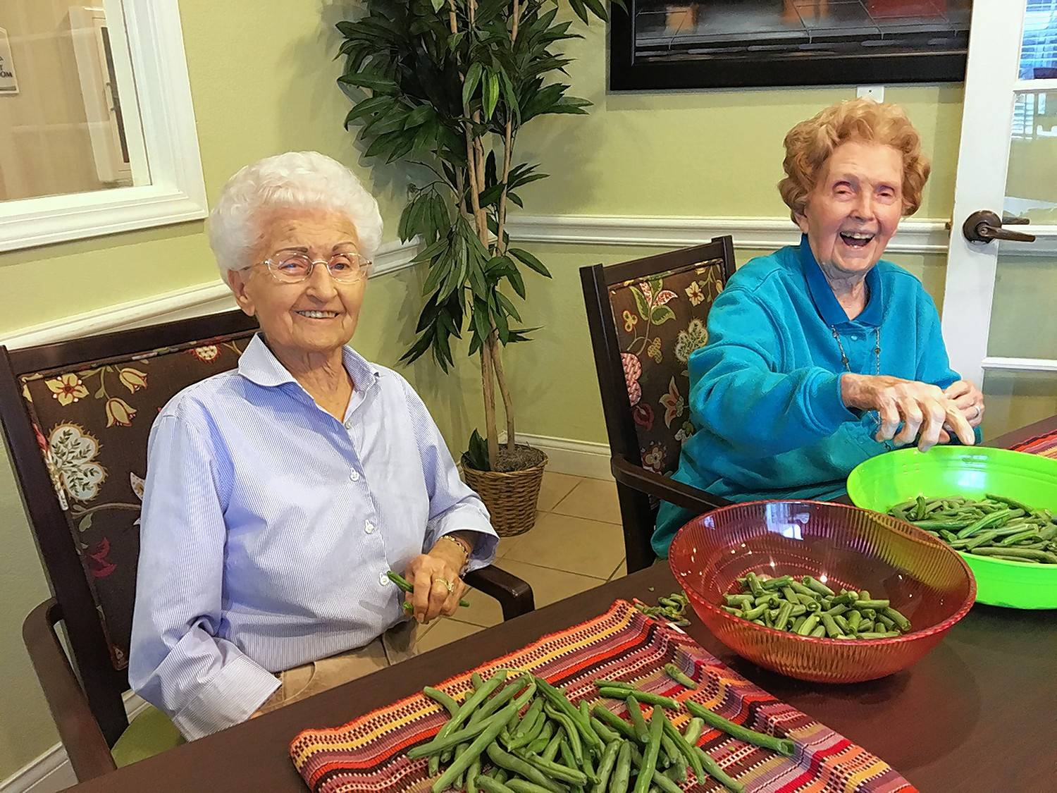 Residents of a memory care facility keep busy during the day with tasks or other activitiese that improve their daily lives.