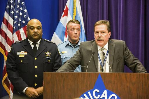 Chicago Police Commander Kevin Duffin, accompanied by Police Superintendent Eddie Johnson, left, and officer Mike Donnelly, rear, speaks during a news conference, Thursday, Jan. 5, 2017, abut the hate crime and other charges filed against four individuals for an attack on a man that was captured on a Facebook video.  (James Foster/Chicago Sun-Times via AP)