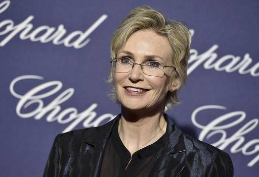 "FILE - In this Jan. 2, 2017 file photo, Jane Lynch arrives at the 28th annual Palm Springs International Film Festival Awards Gala in Palm Springs, Calif. The Emmy and Golden Globe-winning actress will receive an honorary doctoral degree from Illinois State University next month. Lynch is a native of the Chicago suburb of Dolton and a 1982 graduate of Illinois State's theatre program. She is known for her portrayal of cheerleading coach Sue Sylvester on the TV show ""Glee."" (Photo by Jordan Strauss/Invision/AP File)"