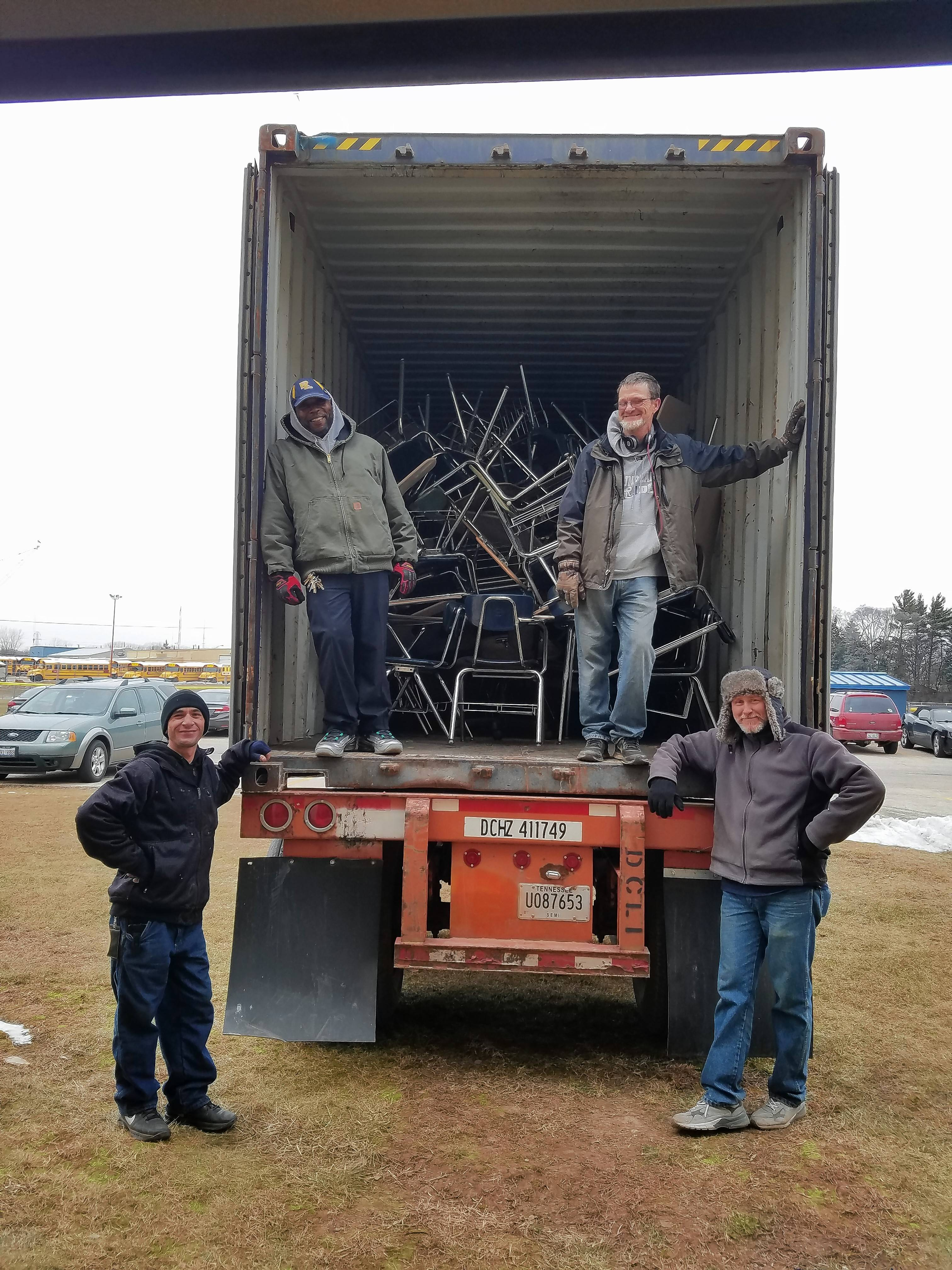These were among the Round Lake Area Unit District 116 workers who on Monday filled two truckloads of excess furniture for a donation to a nonprofit that helps 17 countries in Latin America and the Caribbean. In the rear are Mike Brunson, left, and Dawain Noe. In front are Pat Divittorio, left, and Terry Cagle. The district is sending 568 pieces of furniture to schools in Spanish Town, Jamaica.