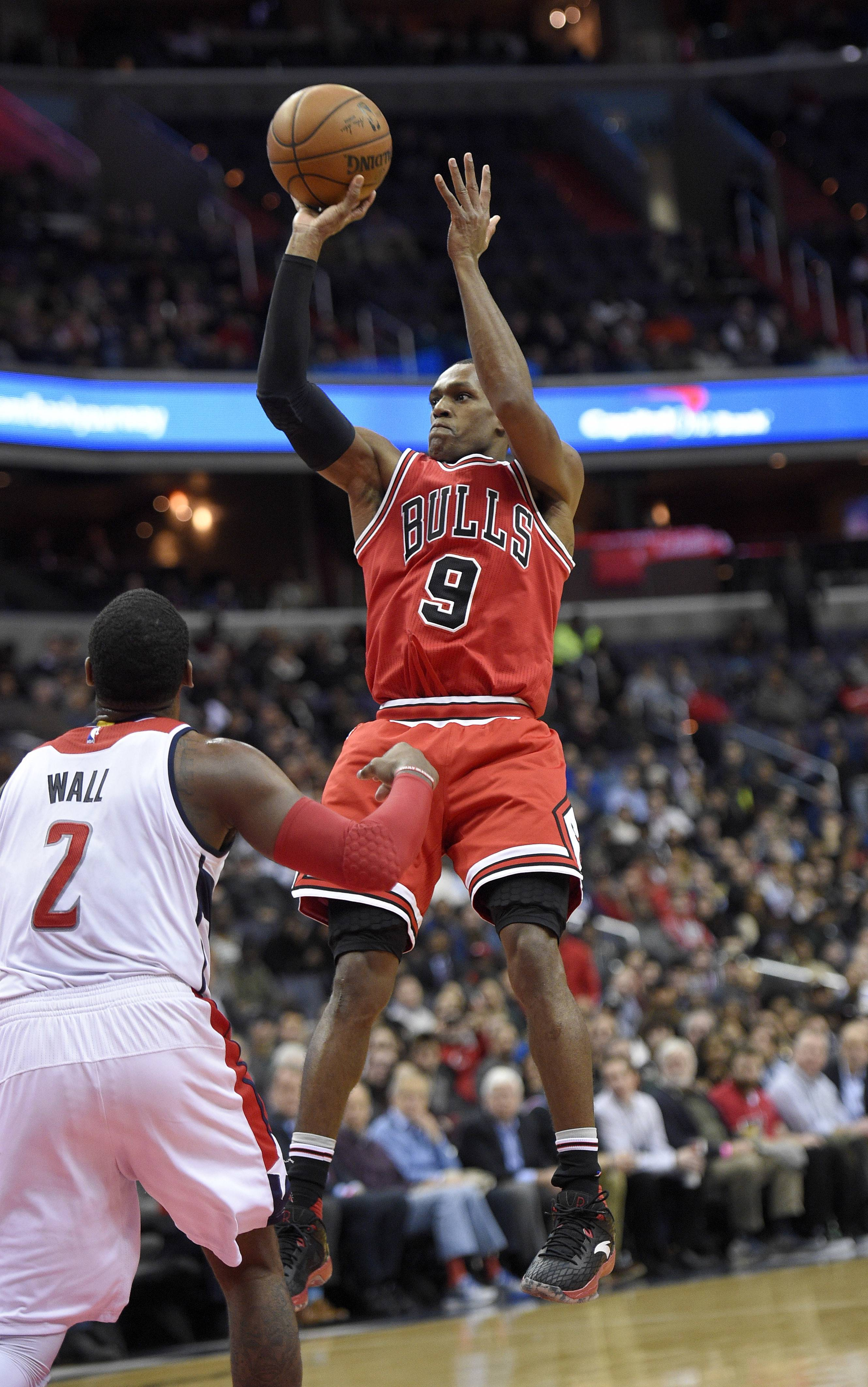 Chicago Bulls guard Rajon Rondo (9) takes a shot against Washington Wizards guard John Wall (2) during the second half of an NBA basketball game, Tuesday, Jan. 10, 2017, in Washington. The Wizards won 101-99. (AP Photo/Nick Wass)