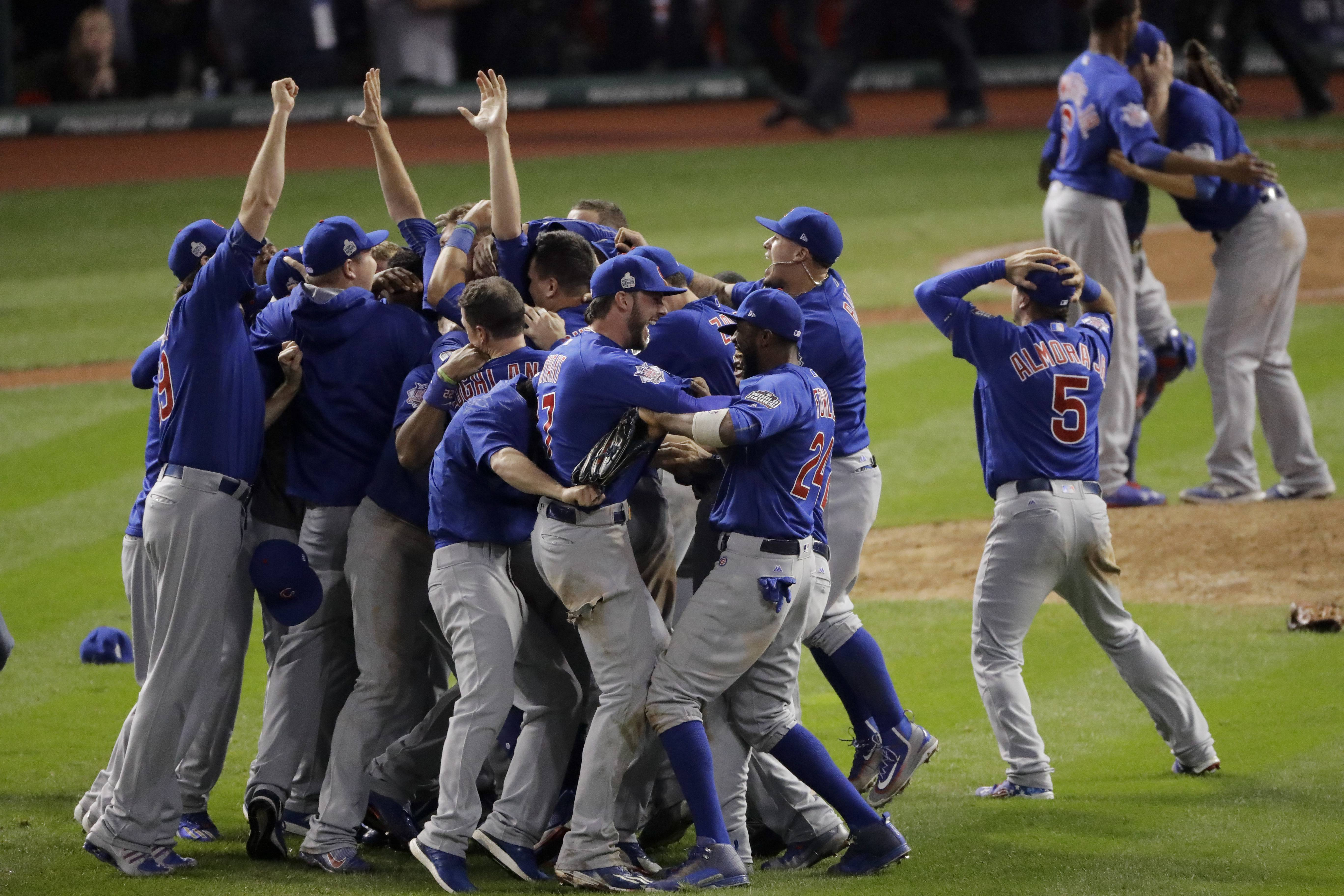 The Cubs celebrate after Game 7 of the Major League Baseball World Series against the Cleveland Indians Thursday, Nov. 3, 2016, in Cleveland. The Cubs won 8-7 in 10 innings to win the series 4-3. The World Series champion Cubs will make a celebratory visit to the White House before President Barack Obama leaves office.