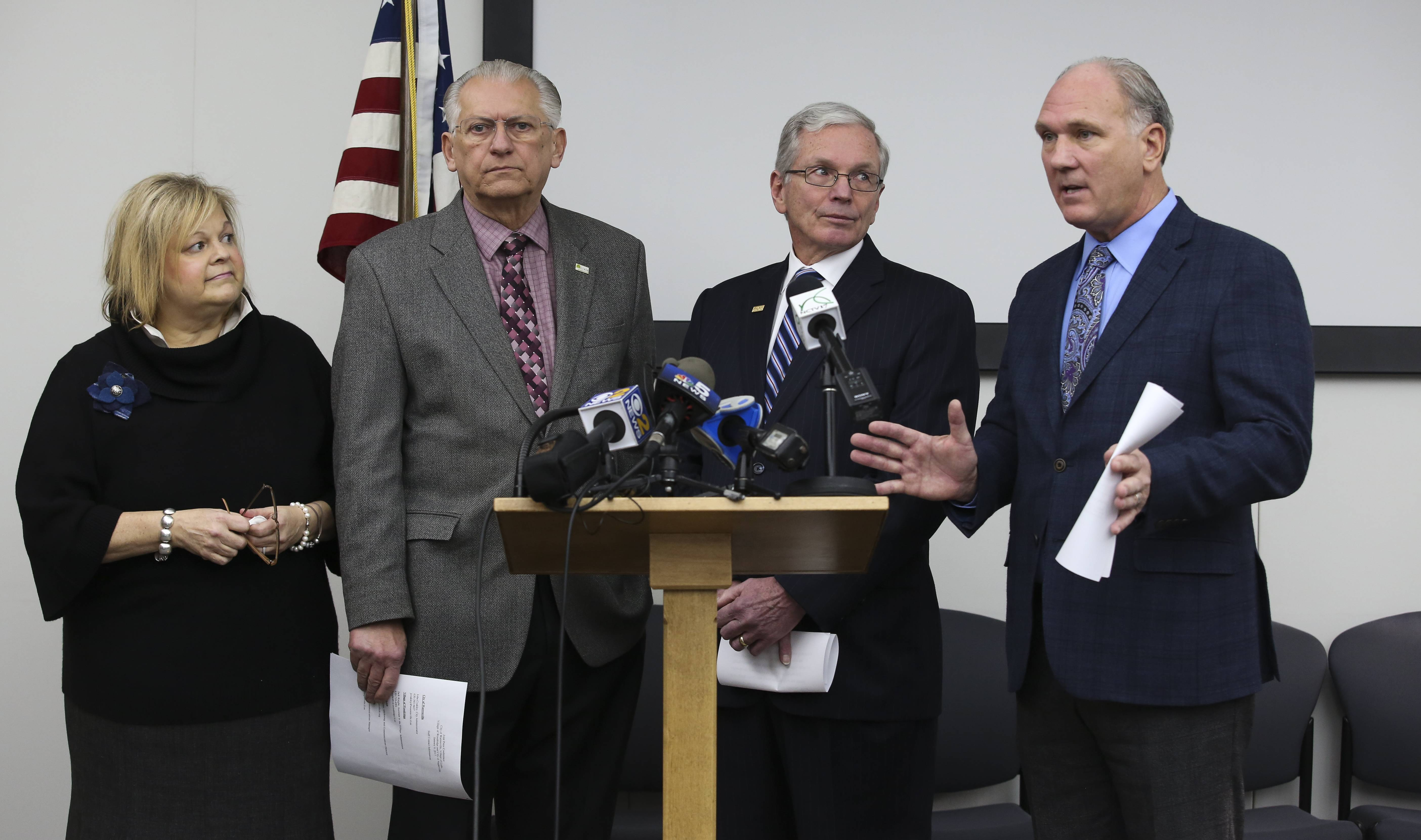 From left, Mayor Gina Cunningham-Picek of Woodridge, Mayor Joseph Broda of Lisle, Mayor David Brummel of Warrenville and Mayor Steve Chirico of Naperville address petitions purporting to seek a merger of their towns.