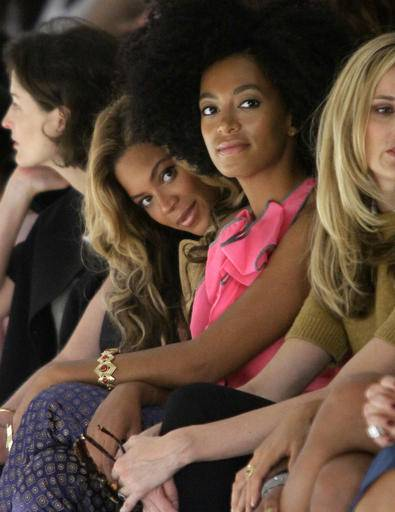 FILE - In this Sept. 13, 2011, file photo, Beyonce Knowles, center left, sits with her sister Solange Knowles during the presentation of Vera Wang's Spring 2012 collection in New York. Beyonce interviewed Solange for Interview magazine in a conversation published online on Jan. 10, 2017. (AP Photo/Bebeto Matthews, File)