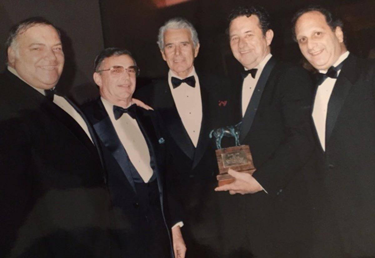 "Sheldon Robbins won the Eclipse Award for his ""herculean efforts"" in pulling off the ""Miracle Million"" after the fire at Arlington Park in 1985. From left are Sheldon Robbins, Dick Duchossois, presenter John Forsythe, Joe Joyce and Ralph Ross."