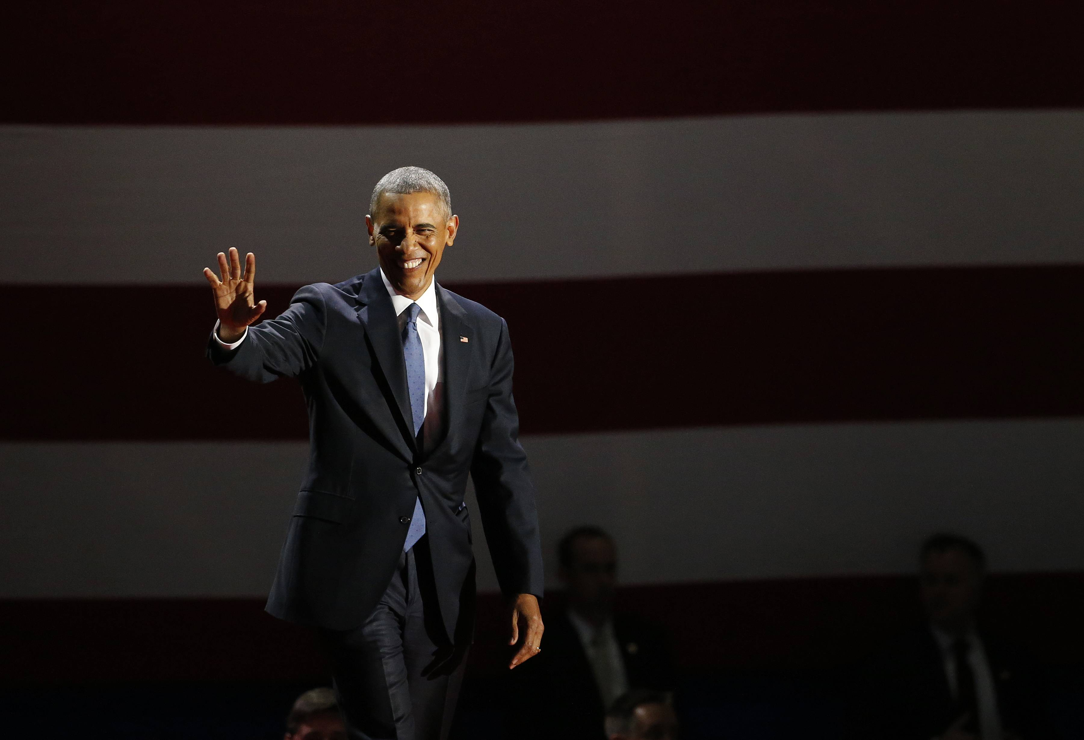 President Barack Obama waves as he arrives to speak at McCormick Place in Chicago, Tuesday.