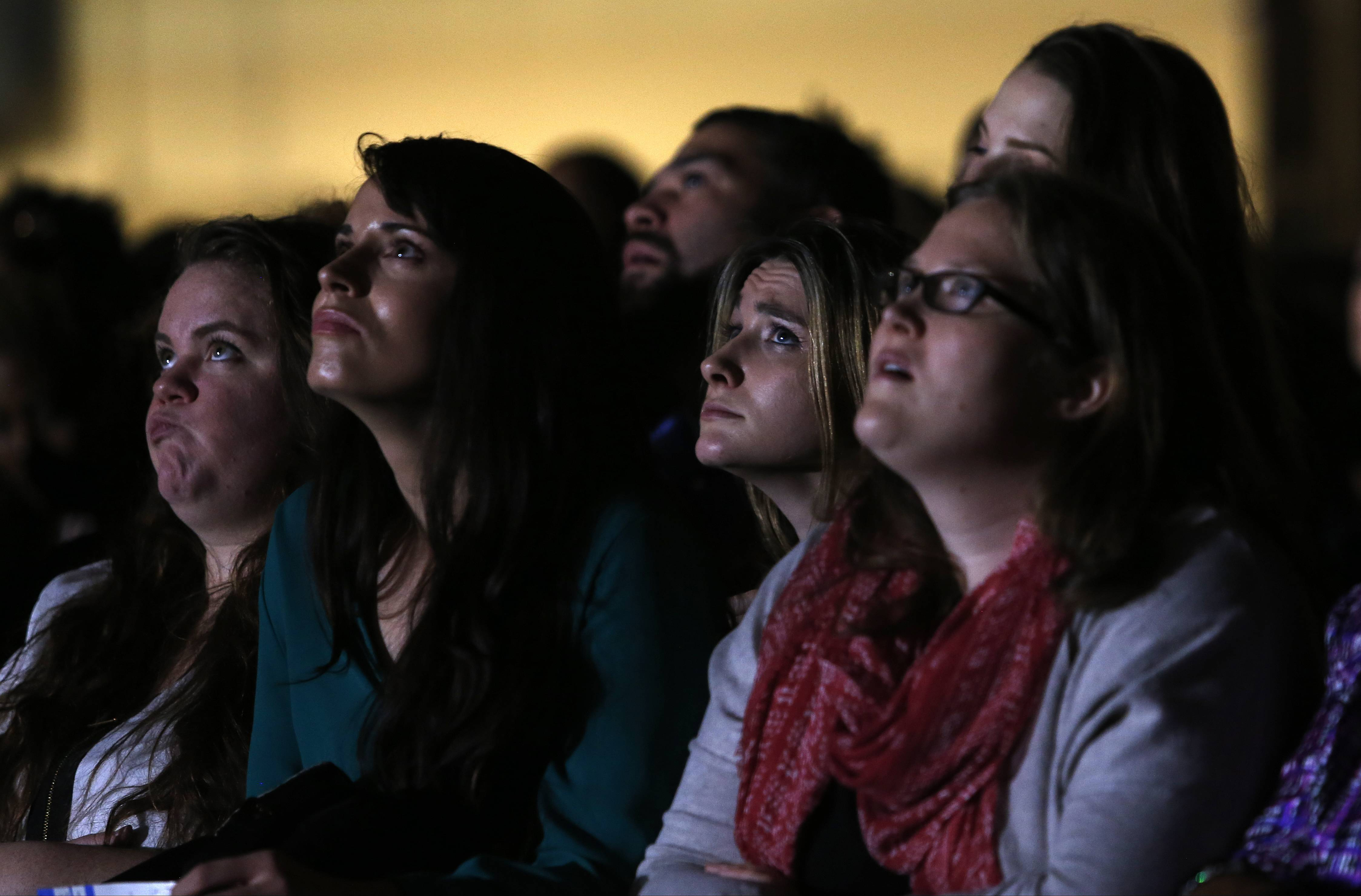 Supporters watch a video presentation before President Barack Obama gives his presidential farewell address at McCormick Place in Chicago, Tuesday.
