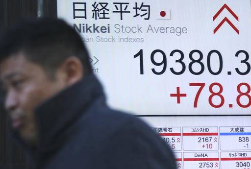 A man walks past an electronic stock board showing Nikkei stock index at a securities firm in Tokyo, Wednesday, Jan. 11, 2017. Asian shares were mostly higher Wednesday morning on the back of a strengthening dollar and quiet trading ahead of remarks by president-elect Donald Trump. (AP Photo/Shuji Kajiyama)