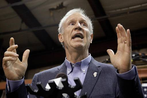 FILE - In this Nov. 16, 2016, file photo, Illinois Gov. Bruce Rauner speaks to reporters in Springfield, Ill. The nation's longest running state budget stalemate is now half way through its second year, as Illinois continues to wallow in its financial crisis and one General Assembly hands off the problem to the next one. The Illinois Senate is aiming to propose its own solution after a new legislature is sworn in on Wednesday, Jan. 11, 2017. (AP Photo/Seth Perlman, File)
