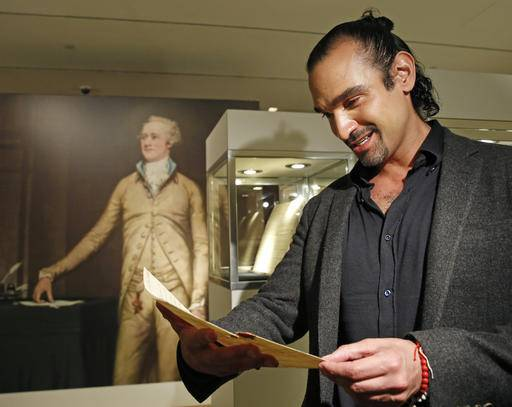 "CORRECTS NAME OF SON FROM PATRICK TO PHILIP- Javier Munoz, who plays Alexander Hamilton in the hit Broadway musical, tears up as he reads a letter from Hamilton's son Philip to his father that starts with the words ""Dear Papa,"" Tuesday, Jan. 10, 2017, in New York. The letter is among a trove of artifacts related to Alexander Hamilton, including love letters to his wife, Eliza, will be offered up for auction at Sotheby's Jan. 18. (AP Photo/Kathy Willens)"