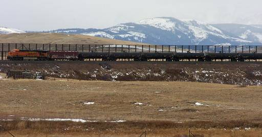 FILE- In this Nov. 7, 2013 file photo, a train hauls oil into Glacier National Park near the Badger-Two Medicine National Forest in northwest Montana. The Interior Department has canceled the final two oil and gas leases in a wilderness area bordering Glacier National Park that's sacred to the Blackfoot tribes of Montana and Canada. (AP Photo/Matthew Brown, File)