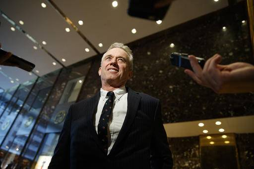 Robert F. Kennedy Jr. talks with reporters in the lobby of Trump Tower in New York, Tuesday, Jan. 10,2017, after meeting with President-elect Donald Trump. (AP Photo/Evan Vucci)