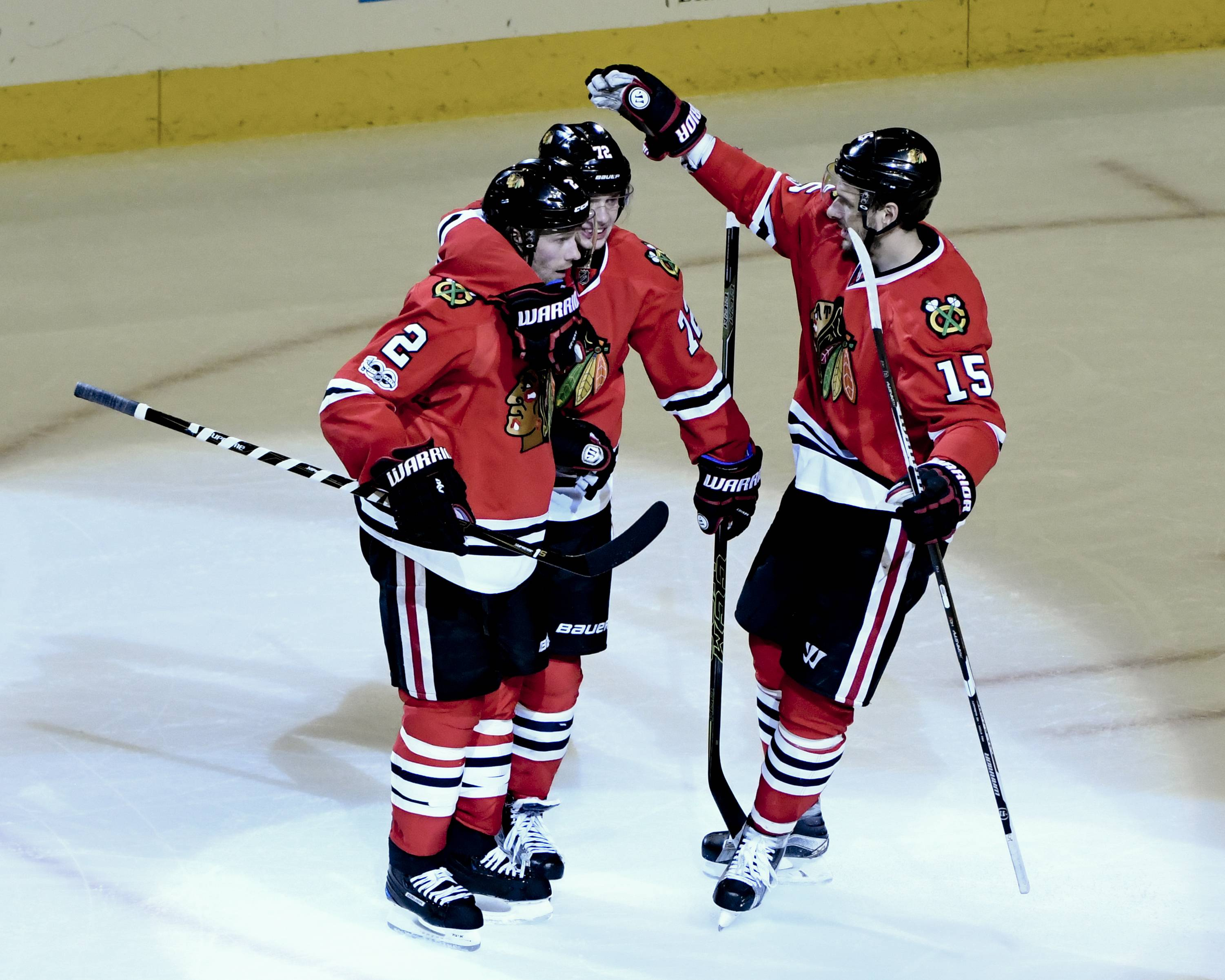 Chicago Blackhawks defenseman Duncan Keith (2) celebrates his overtime goal against the Detroit Red Wings with left wing Artemi Panarin, center, and center Artem Anisimov (15) in an NHL hockey game Tuesday, Jan. 10, 2017, in Chicago. The Blackhawks won 4-3.