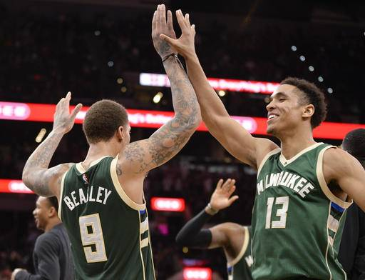 Milwaukee Bucks' Malcolm Brogdon (13) and Michael Beasley celebrate after the Bucks defeated the San Antonio Spurs 109-107 in an NBA basketball game Tuesday, Jan. 10, 2017, in San Antonio. (AP Photo/Darren Abate)