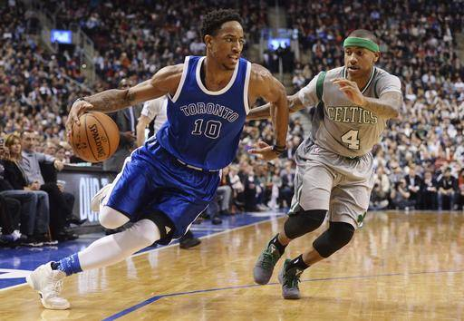 Toronto Raptors guard DeMar DeRozan (10) drives past Boston Celtics guard Isaiah Thomas (4) during the second half of an NBA basketball game Tuesday, Jan. 10, 2017, in Toronto. (Nathan Denette/The Canadian Press via AP)